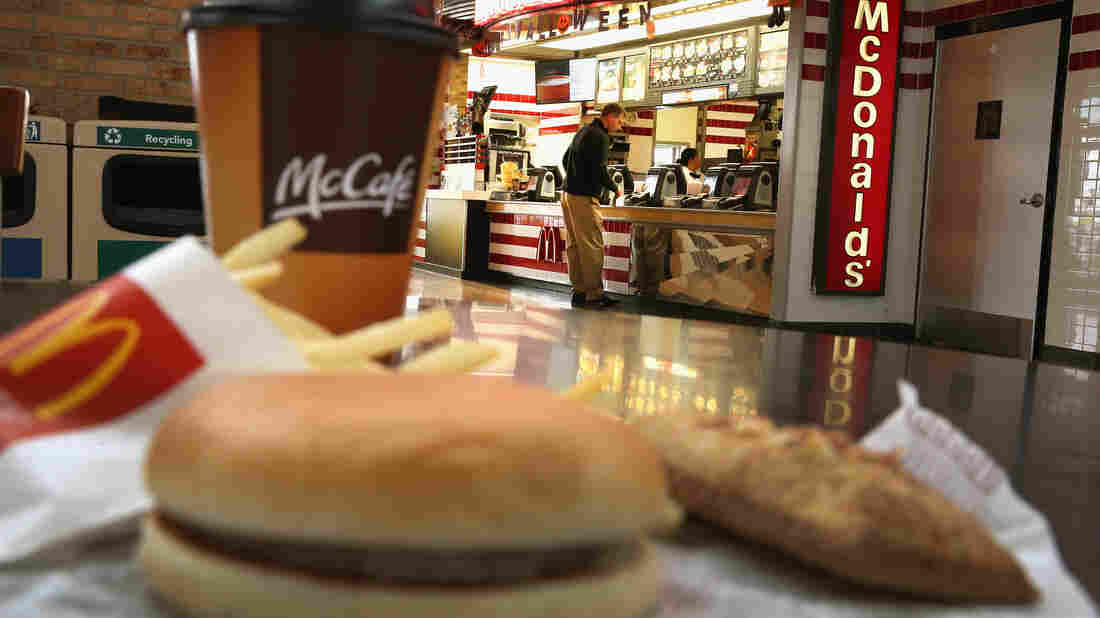 "Customers order food from a McDonald's restaurant in Des Plaines, Ill. The company has promised to start buying ""verified sustainable beef&qu"