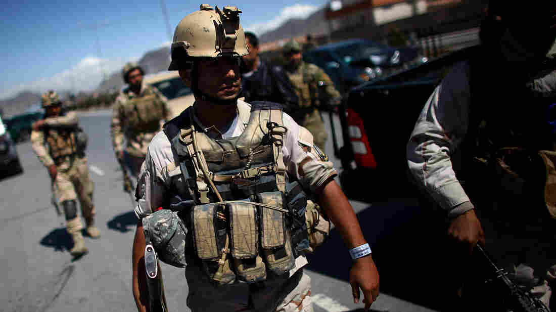 Afghan Special Forces converge on an Independent Election Commission office after the Taliban launched an assault on the compound Tuesday in Kabul. Two suicide bombers detonated their vests outside the offices while gunmen stormed the building.