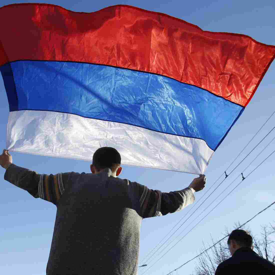 An activist carries a Russian flag during a rally on Sunday in eastern Ukraine.