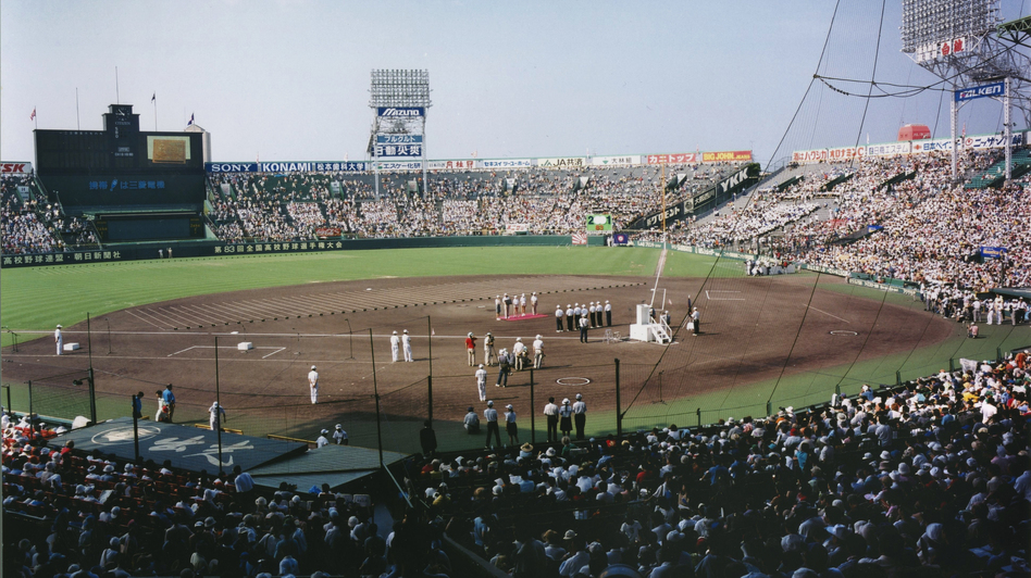 Theo and her family in Koshien Stadium during the opening ceremonies for the high-school baseball championship in Japan in 2001. (Courtesy of Theo Balcomb)