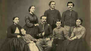 Horace Wilson and other members of his family in a portrait believed to date to the 1860s. He's the mustachioed fellow standing at top right.