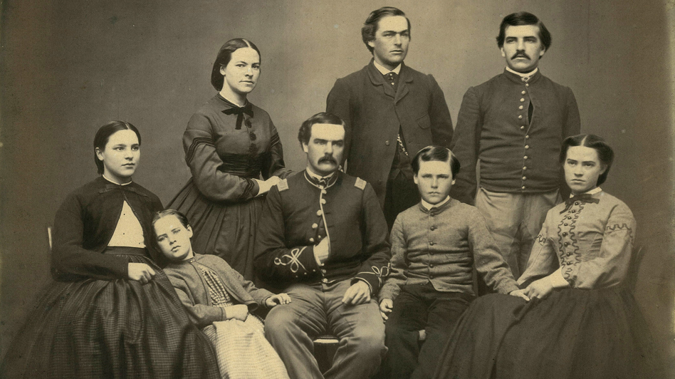 Horace Wilson and other members of his family in a portrait believed to date to the 1860s. He's the mustachioed fellow standing at top right. (Courtesy of Abigail Sanborn)
