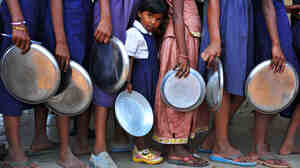 Indian schoolchildren wait in line for food at a government primary school in Hyderabad, India. Consistent access to nutritious food and clean water is key to helping children thri