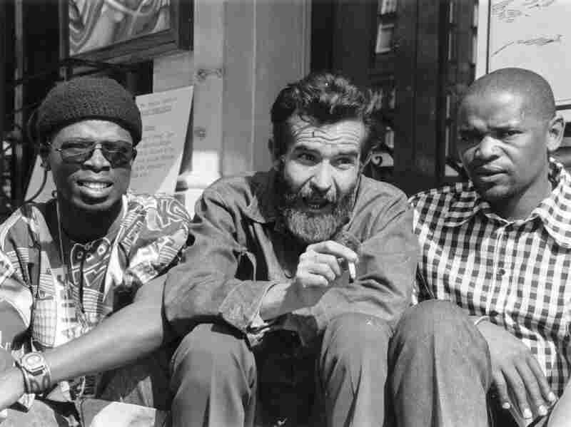 Fugard sits with South African actors John Kani (left) and Winston Ntshona at the Royal Court Theatre, where they staged Sizwe Bansi Is Dead in September 1973.