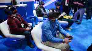Attendees wear Oculus Rift HD virtual reality headsets at the Consumer Electronics Show in January.