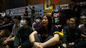Students continue their week-long occupation of Taiwan's legislature.