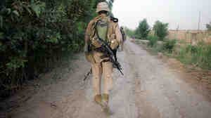 A U.S. Marine walks during a security patrol on May 13, 2007, in Iraq's Anbar province