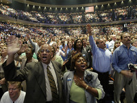 Worshippers gather at Lakewood Church's facility in Houston, led by televangelist Joel Osteen, whose program appears on Daystar. In 2005, the ministry spent $75 million to renovate its church in order to accommodate 16,000 people.