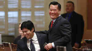 State Sen. Leland Yee, D-San Francisco, right, and Sen. Kevin de Leon, D-Los Angeles, celebrate the passage of their gun control measures during the Senate session at the Capitol in Sacramento, Calif., in 2013.