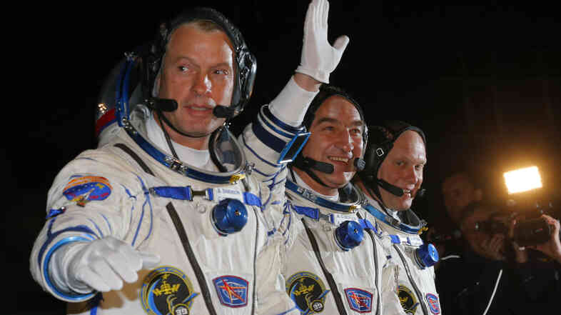 From left: U.S. astronaut Steve Swanson, and Russian cosmonauts Alexander Skvortsov and Oleg Artemyev prior to the launch of their Soyuz-FG rocket Wednesday at the Baikonur Cosmodrome in Kazakhstan.