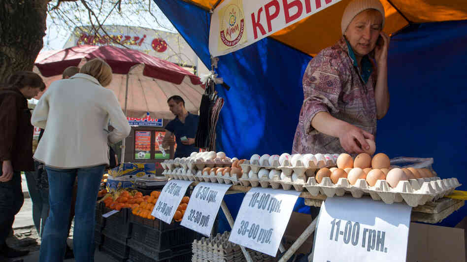 A street vendor in Simferopol, Crimea, sells eggs with the dual currency price tags in Russian rubles and Ukraini