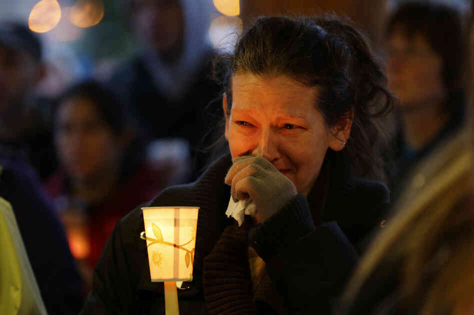 Teresa Welter cries at a candlelight vigil Tuesday in Arlington, Wash., for the victims of Saturday's disaster. At least 24 people died and many more are still missing.