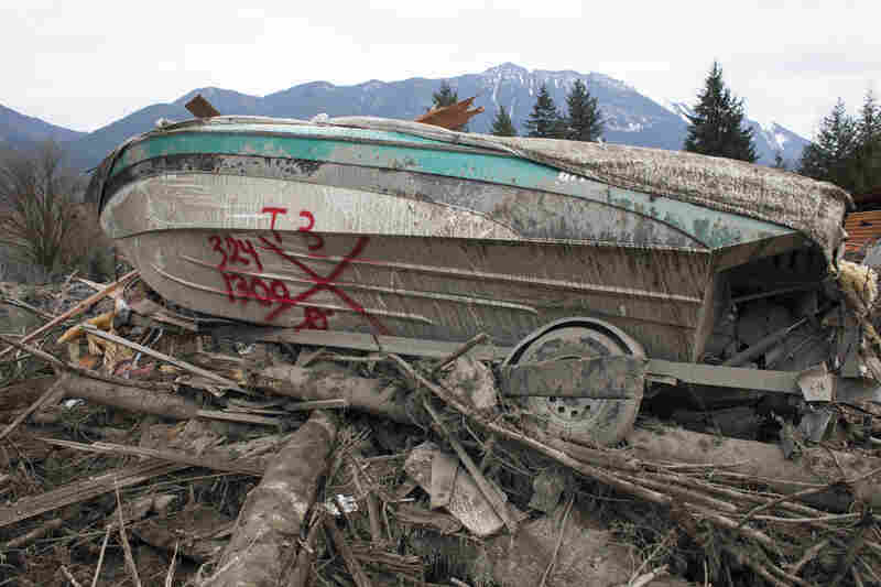 A boat sits in ruins in the aftermath of the mudslide and related flooding.