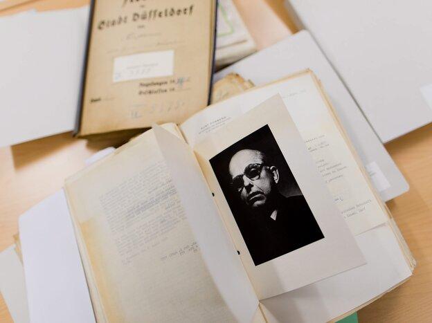 An obituary card with a portrait of German art dealer Hildebrand Gurlitt (1895-1956), the father of Cornelius Gurlitt, in a folder at the municipal archive in Duesseldorf, Germany.