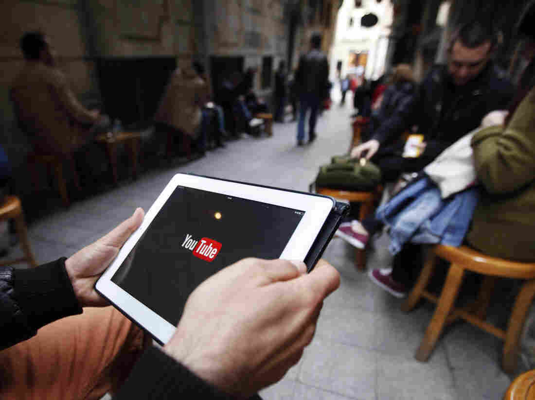 A man tries to get connected to YouTube with his tablet at a cafe in Istanbul on Thursday.