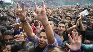 Fans attend the second day of the Vive Latino 2013 Music Fest at the Foro Sol in Mexico City.