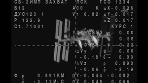The Soyuz approaches the International Space Station.