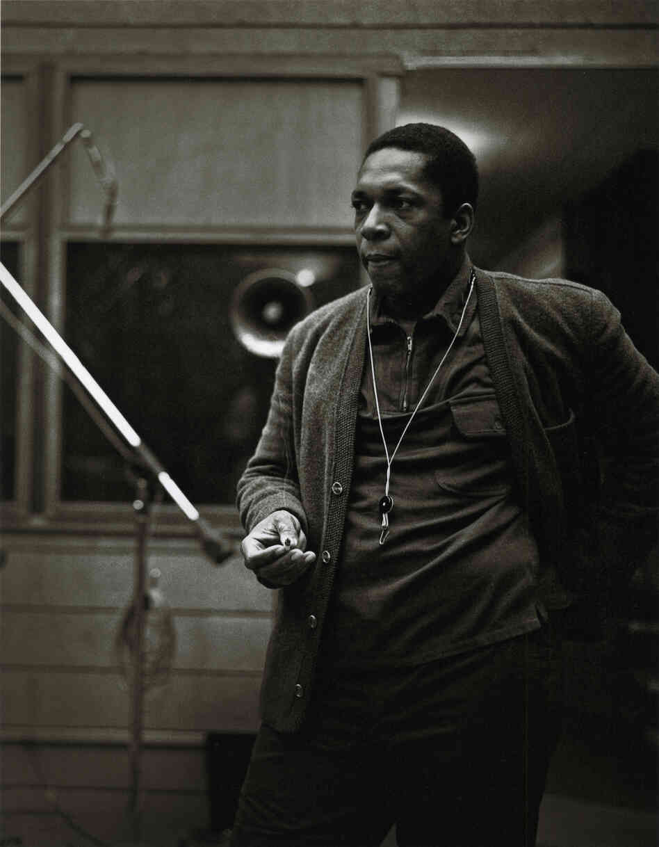 John Coltrane at the recording sessions for A Love Supreme. In addition to the images already published, photographer Chuck Stewart recently unearthed never-before-seen shots of the session, including this one. Per the request of Chuck Stewart's family, reproduction of these photos elsewhere is prohibited.