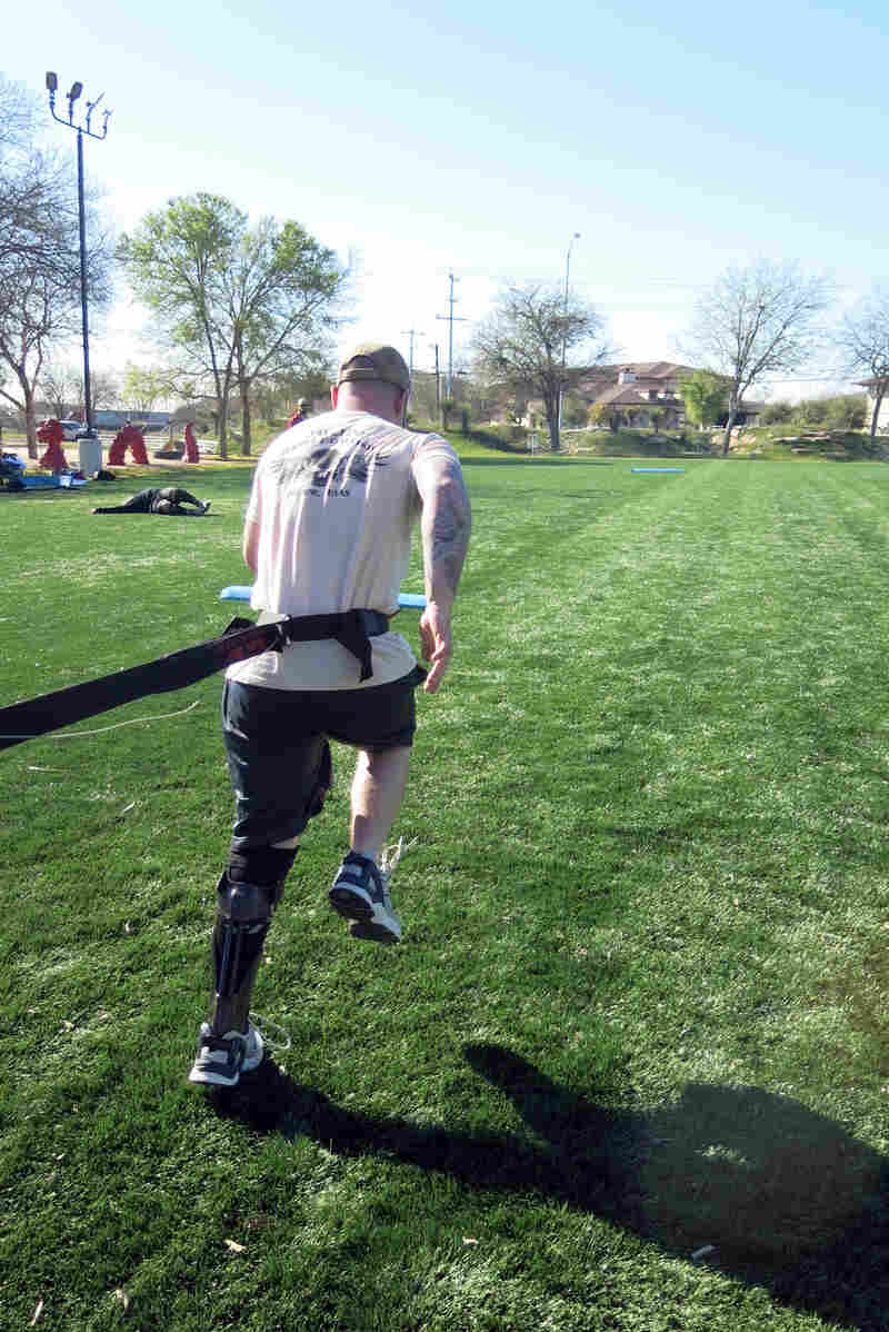 """Army Spc. Joey McElroy practices resistance running with the IDEO. Soldiers who are fitted with the brace spend four weeks learning how to use it in a """"Return to Run"""" program."""