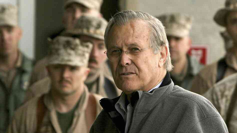 Donald Rumsfeld, shown here on a 2006 visit to Iraq, was the Secretary of Defense during the beginning of the U.S. wars in Iraq and Afghanistan. Errol Morris spent over 30 hours interviewing Rumsfeld for his latest documentary.