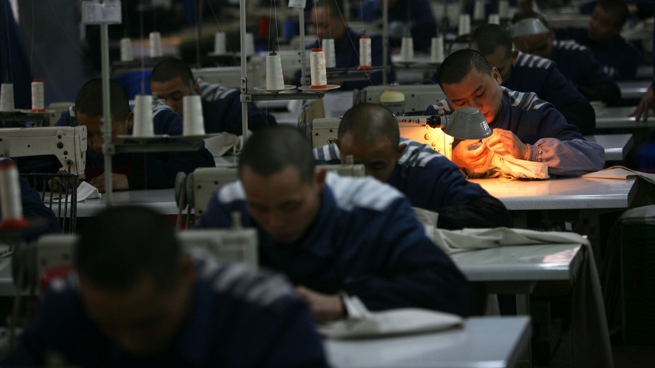 Inmates work on sewing machines at a prison in 2008 in Chongqing Municipality, China. said last year that it had halted programs of reeducation through labor camps.