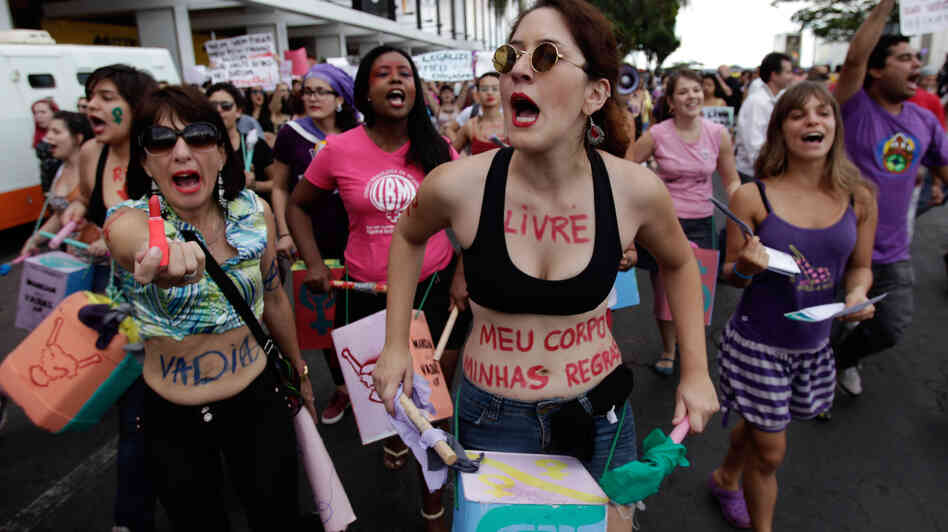 Demonstrators rally to protest sexism in Brasilia, Brazil, last June. A new protest erupted last week after a study released by Brazil's Institute for Applied Economic Research reported 65 percent of Brazilians believe women who dress provocatively deserve to be attacked.