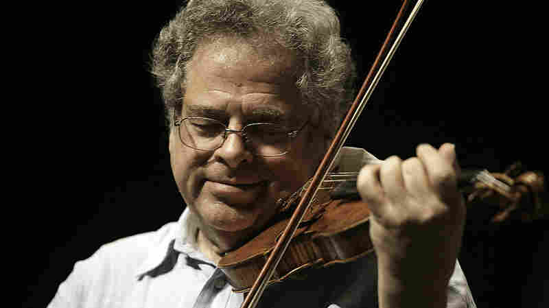 Itzhak Perlman plays his 1714 Soil Stradivarius violin in rehearsal with the East Texas Symphony Orchestra at the University of Texas at Tyler on April 4, 2009.
