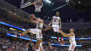 Arizona guard Gabe York (1) pulls down a rebound as teammate Rondae Hollis-Jefferson (23) watches during a regional semifinal NCAA college basketball tournament game against San Diego State, Thursday in Anaheim, Calif.