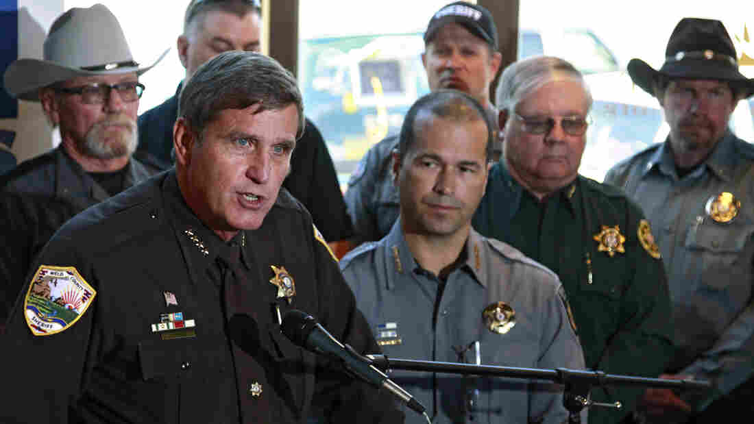 It's a legal battle that is far from over. In 2013, Sheriff John Cooke (left) and other sheriffs in Colorado filed a federal civil lawsuit objecting to two gun control bills, saying they violate the Second Amendment. This week a crucial gun control measure goes to trial.