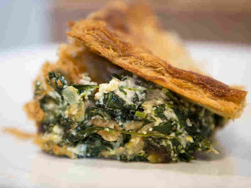 "Hall writes that the trick to great spanakopita is ""to eat it when it's still hot so the top is all shattery, the center creamy and the bottom crisp."""
