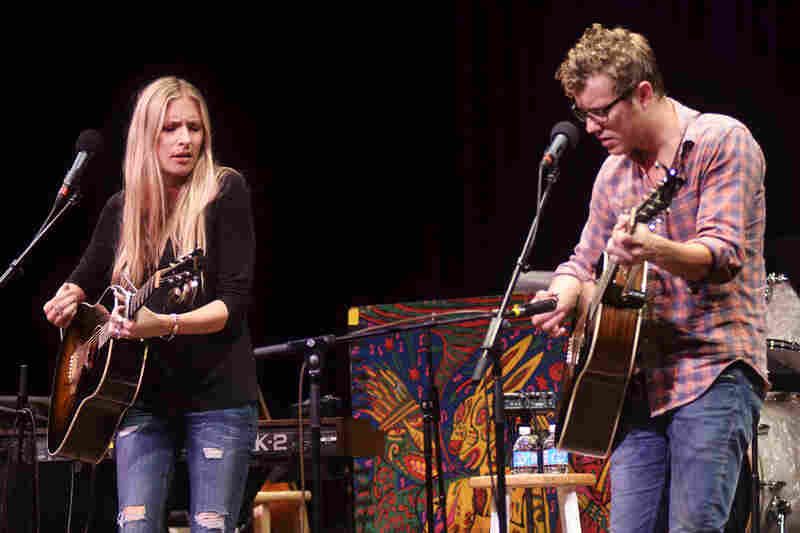 For her Mountain Stage set, Holly Williams plays guitar and piano. She is backed by guitarist Anderson East.