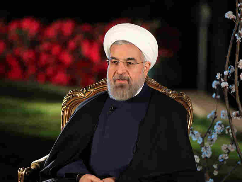 Iranian President Hassan Rouhani, shown in Tehran on March 20. Iran has strongly supported Syrian President Bashar Assad in that country's civil war, and some Iranians are starting to question the cost.