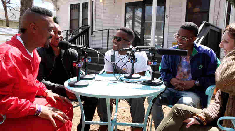 The Outfit, TX with Microphone Check. From left to right, JayHawk, Ali Shaheed Muhammad, Mel, Dorian and Frannie Kelley.