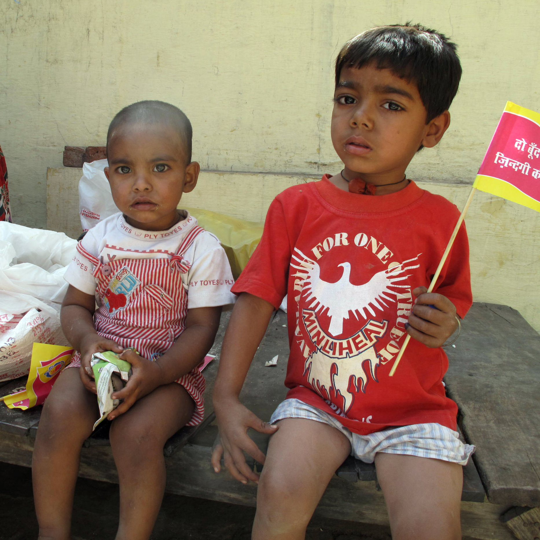 Polio campaigns are no longer just for fighting polio. Here three kids get snacks at a vaccination booth in Moradabad, India, to help prevent malnutrition.