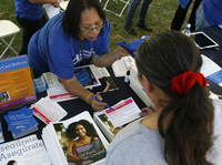 Planned Parenthood worker Alicia Gonzales promotes the Affordable Care Act during an outreach event for the Latino community in Los Angeles in September.