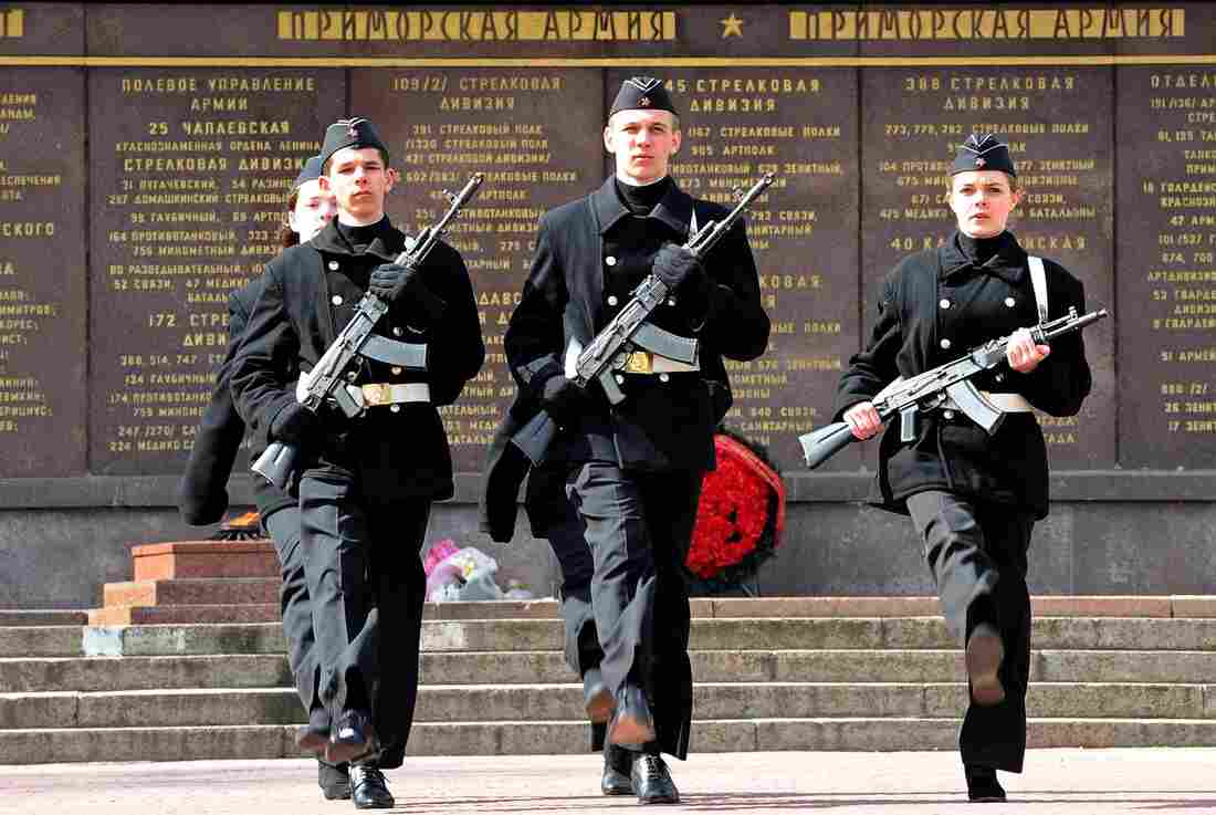 Senior high school students wearing Soviet-era navy uniform march during a daily ceremony of changing the guard of honor at the WW II Memorial to the Heroes of the defense of Sevastopol 1941-1942 in Sevastopol, Crimea, Saturday. Russia says it doesn't plant to invade mainland Ukraine.