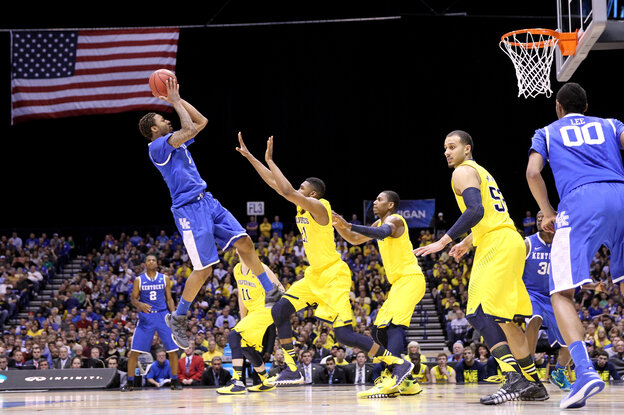 Kentucky's James Young pulls up for a shot against the Michigan Wolverines on Sunday.