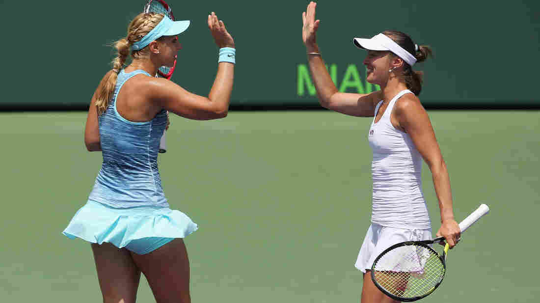 Martina Hingis of Switzerland and Sabine Lisicki of Germany celebrate match point during Sunday's final of the Sony Open. The pair won, bringing Hingis her first victory since 2007.