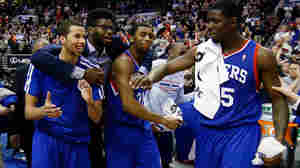 What a difference a win makes: The 76ers' (top, from left) Michael Carter-Williams, Hollis Thompson and Henry Sims celebrate Saturday's win with teammate Nerlens Noel (in suit), ending a 26-game losing streak. Below, the trio after another loss Thursday.