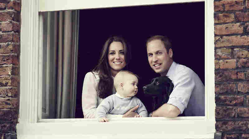 Prince William, Duke of Cambridge, and Catherine, Duchess of Cambridge, pose with their son, Prince George, for an official family portrait at Kensington Palace.