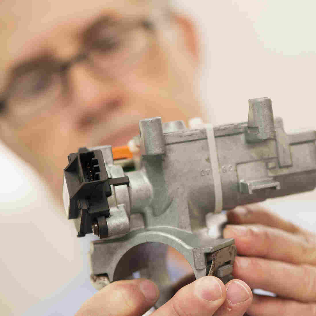 Consulting materials engineer Mark Hood shows the ignition assembly that has a faulty ignition switch (black piece at left), in the mechanical testing laboratory at McSwain Engineering Inc. in Pensacola, Fla. The firm helped to conduct the engineering investigations and failure analysis that resulted in the GM recall.