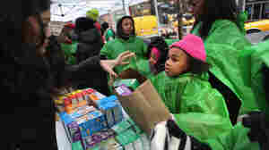 Girl Scouts sell cookies on Feb. 8, 2013, as a winter storm moves in on New York City.