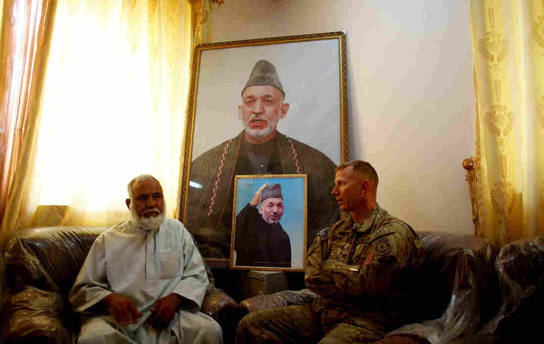 Panjwai district Gov. Haji Faizal Mohammad meets with U.S. Army Col. Douglas Sims. U.S. troops pushed the Taliban out and stabilized the region; Afghan forces are now in control of the territory in the southern province of Kandahar.