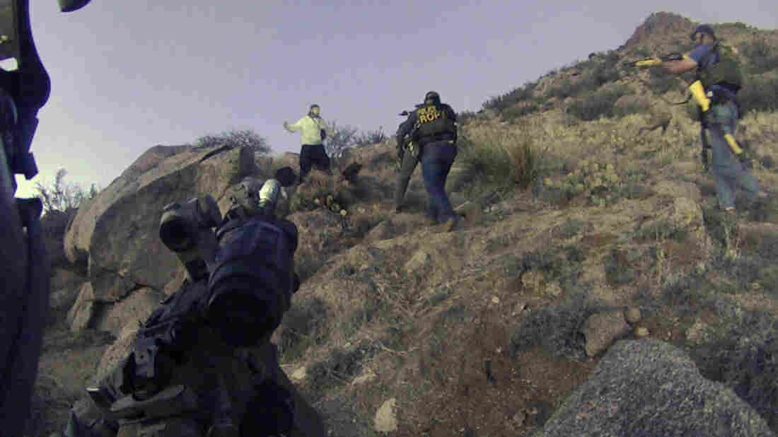 An image from a police video of March 16, shows Albuquerque, N.M., police officers in a standoff with James Boyd, an illegal camper in the city's foothills. Boyd died after being shot by officers.