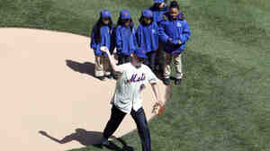 New York Mayor Bill de Blasio throws the ceremonial first pitch Tuesday. Even though he was flanked by children, the Mets home crowd booed de Blasio — an unabashed Red Sox fan.