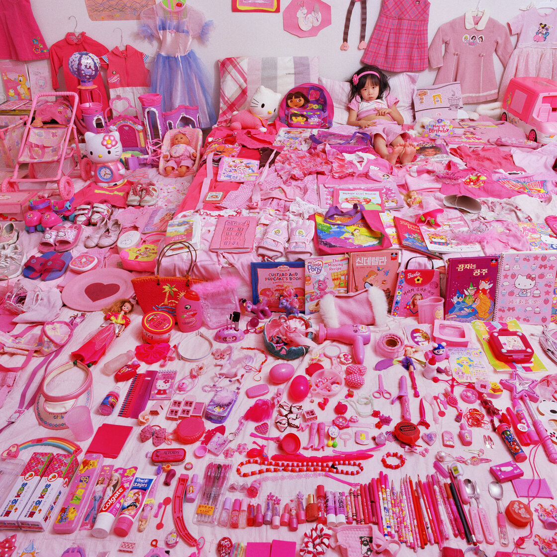 Photographer JeongMee Yoon felt her daughter's life was being overtaken by pink. She illustrated that in her 2006 portrait Seo Woo and Her Pink Things.