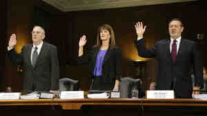 Caterpillar Inc Vice President for Finance Services Julie Lagacy is flanked by former Senior International Tax Manager Rodney Perkins (left) and Chief Tax Officer Robin Beran (right) as they are sworn in to testify on Tuesday.