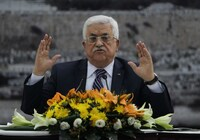 Palestinian president Mahmud Abbas speaks during a meeting at his headquarters in the West Bank city of Ramallah Tuesday, during which he signed a request to join 15 United Nations agencies.