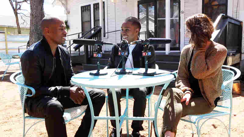 Lunice, center, being interviewed by Microphone Check's Ali Shaheed Muhammed, left, and Frannie Kelley, right.