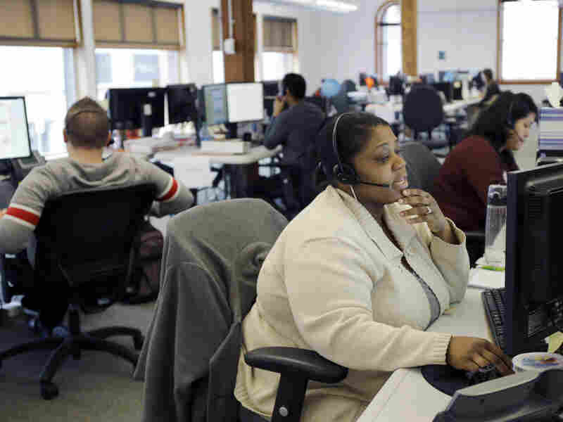 Loretha Cager talks with an applicant at MNSure's call center in St. Paul, Minn., Monday. Monday was the open enrollment deadline for signing up for insurance under the Affordable Care Act.